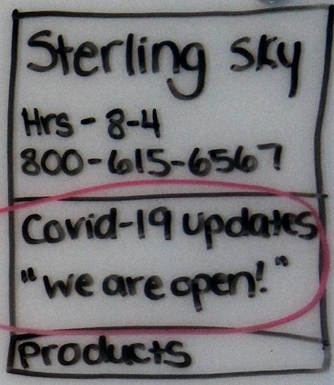 Ручной рисунок листинга GMB для Sterling Sky с красным кружком вокруг сообщения Google о COVID-19.